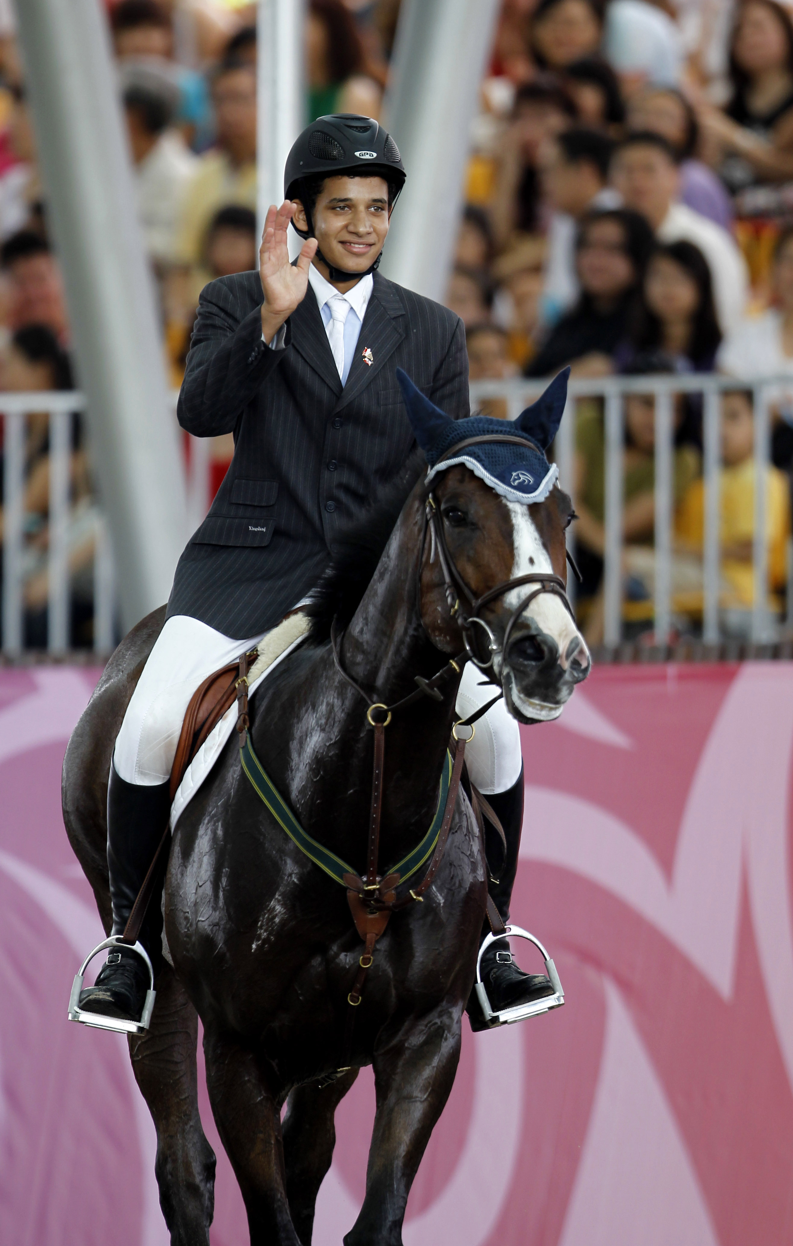 Mohamed Abdalla (EGY) acknowledges the crowds support after jumping a clear with Buzzword in todays individual competition for a share in the lead going into Tuesdays Final. (Photo: IOC)