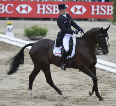Defending champion Michael Jung (GER) is outstanding in the Dressage arena on the youngster Halunke FBW to establish a clear lead in the individual standings and keep Germany at the top of the team leader board at the HSBC FEI European Eventing Championships in Malmö (SWE)