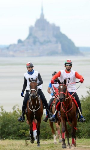Winners HE Sheikh Hamdan bin Mohammed Al Maktoum (left) and Nikos, with HE Sheikh Rashid Dalmook Al Maktoum and Yamamah pictured in front of the iconic Mont Saint-Michel at today's Endurance test event for the Alltech FEI World Equestrian Games™ in Normandy 2014